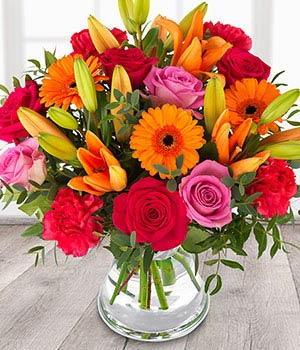 send flowers a vibrant cheerful mix of orange lili