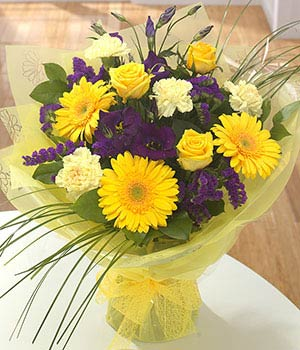 bold yellow gerbera roses carnations and purple fl