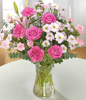 beautiful pink lilies, roses and spray carnations