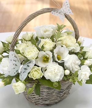 basket of flowers delivered by florists with roses