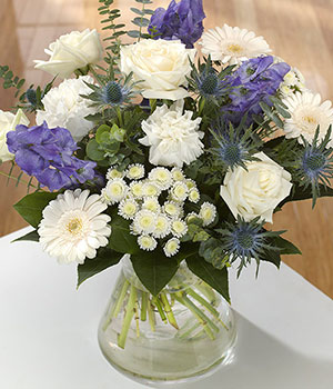purple and white roses carnations and chrysanthemu