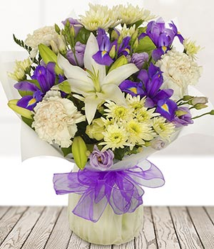 send white and purple flowers lilies iris chrysant