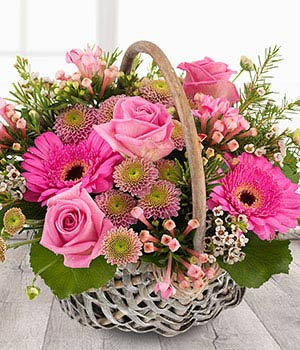 Secret garden pink flower basket delivered same day pink roses pink gerberas flower basket delivered s mightylinksfo
