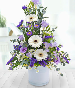 lilac container arrangement with lisianthus and wh