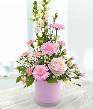 pink roses gerberas carnations and white antirrhin