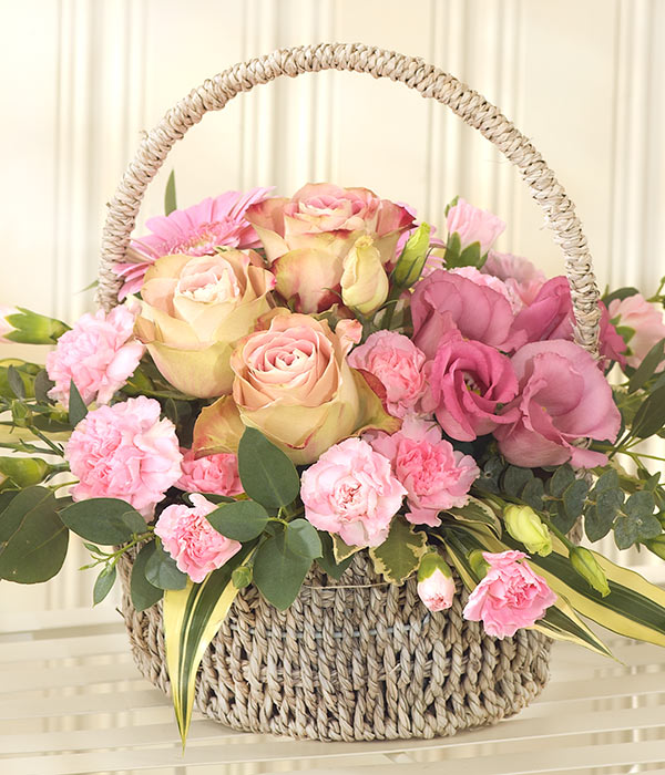 pink roses lisianthus and carnations presented in