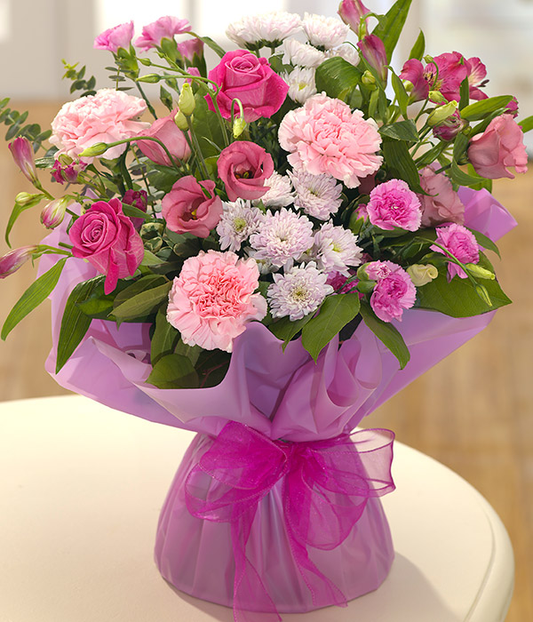 pink roses, carnations and lisianthus flower deliv