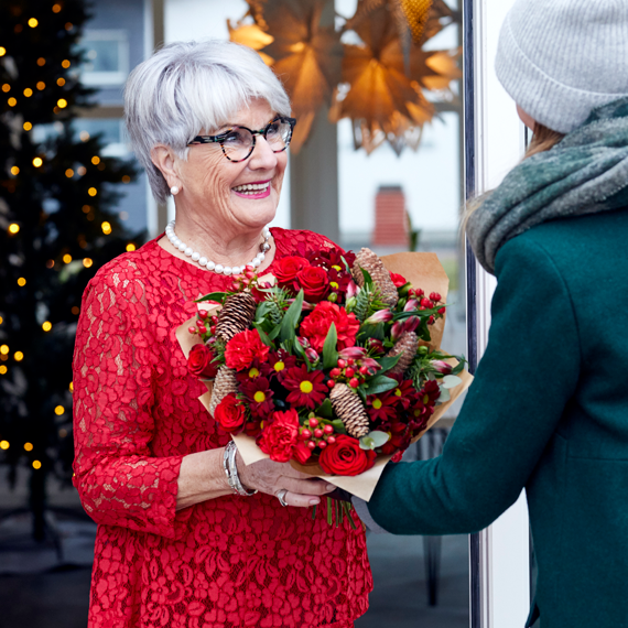 Christmas flowers being gifted